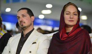 مهناز افشار و همسرش در مگامال تهران با شال قرمز