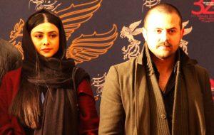 آزاده صمدی با پالتو زرشکی و هومن سیدی با کت و شال در جشنواره فیلم فجر