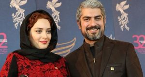 بهنوش طباطبایی با مانتو قرمز مشکی و تیپ مشکی مهدی پاکدل در جشنواره