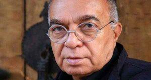 عکس پرتره مسعود فروتن با لباس مشکی و عینک