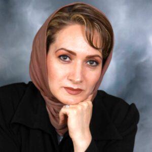 افسانه ناصری با پالتو مشکی و روسری قهوه ای