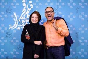 رامبد جوان با پیراهن نارنجی در کنار همسرش در جشنواره فیلم فجر