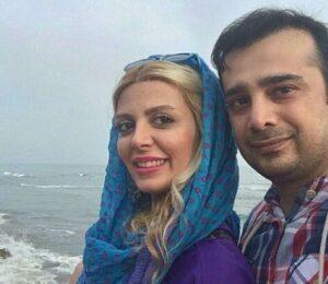 سپند اميرسليماني با پیراهن چهارخونه و همسرش در کنار دریا