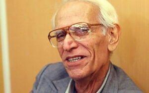 محمود بنفشهخواه با کت طوسی و پیراهن سفید