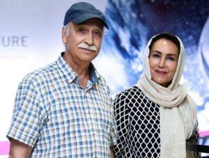 محمود پاک نیت با پیراهن چهارخونه سفید و همسرش مهوش صبرکن