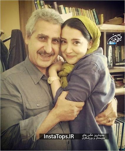 سحر جعفری جوزانی با شال زرد در آغوش پدرش