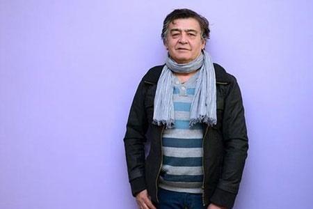 رضا رویگری چپ دست با شال گردن آبی