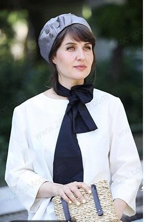 گلوریا هاردی فرانسوی با کلاه و لباس سفید